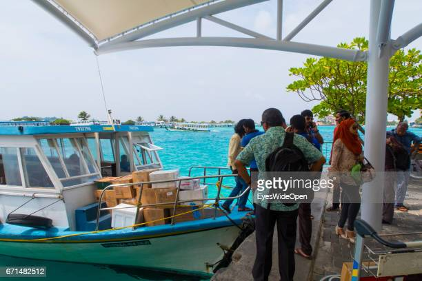Local people waiting at the boat jetty of Malé International Airport for a ferry on February 20 2017 in Male Maldives