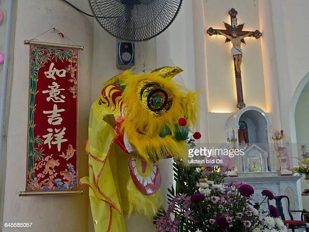 Local people worship at St Francis Xavier catholic church in Malacca a UNESCO World Heritage Site Malaysia