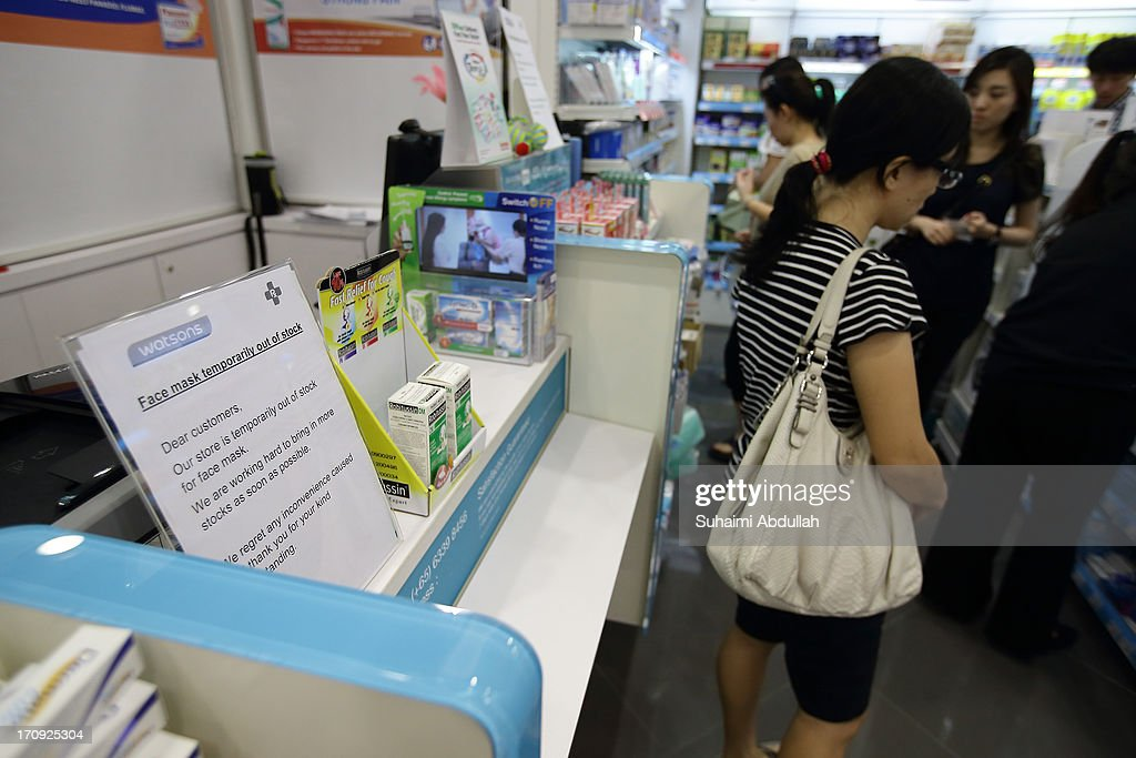 A local pharmacy puts up an out of stock notice for face masks on June 20, 2013 in Singapore. The Pollutant Standards Index (PSI) rose to the highest level on record yesterday, registering at 321 at 10pm. The haze is created by deliberate slash-and-burn forest fires started by companies in neighbouring Sumatra.