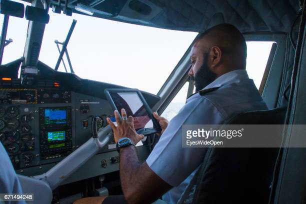 Local Pilot in the Cockpit is flying a Seaplane of Trans Maldivian Airways on February 23 2017 in Male Maldives
