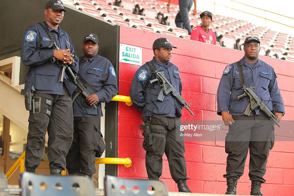 Local police officers guard the exit during a World Cup Qualifier between Trinidad and Tobago and the United States as part of the FIFA World Cup Qualifiers for Russia 2018 at Hasely Crawford Stadium on November 17, 2015 in Port of Spain, Trinidad & Tobago.
