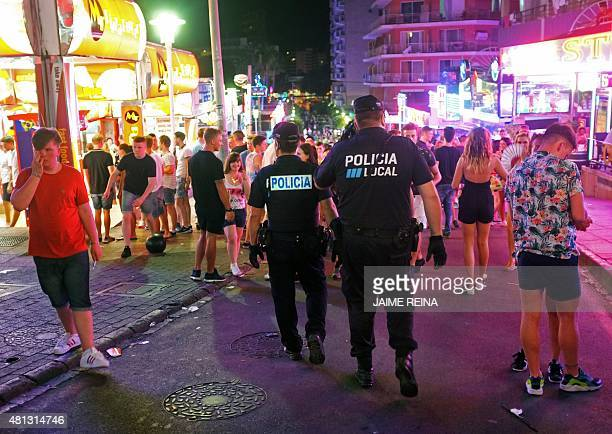 Local policemen patrol the crowded Punta Ballena street in Magaluf holiday resort in Calvia on the Spanish Mallorca Island on July 19 2014 Known...