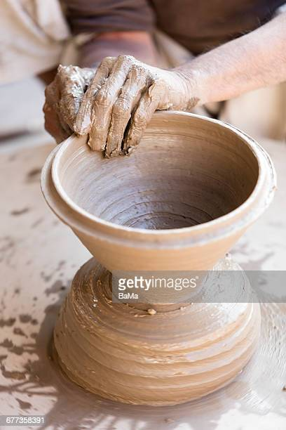 Local potter forming clay pot, Rajasthan, India
