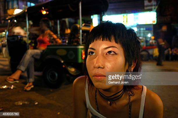 A local punk girl on the popular Khao San Road The police leave punks alone even though they drink large amounts of alcohol There is a curfew for...