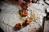 A Local put ingredients on fix weight molasses Chaku for final consuming on 06 January 2015 at Tokha Kathmandu Nepal for the celebration of Maghe...