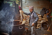 A local put Raw Hardened molasses to prepare molasses Chaku on 06 January 2015 at Tokha Kathmandu Nepal for the celebration of Maghe Sankranti...