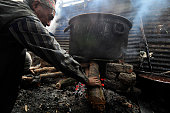 A local puts wood to make fire to prepare molasses Chaku on 06 January 2015 at Tokha Kathmandu Nepal for the celebration of Maghe Sankranti Festival...