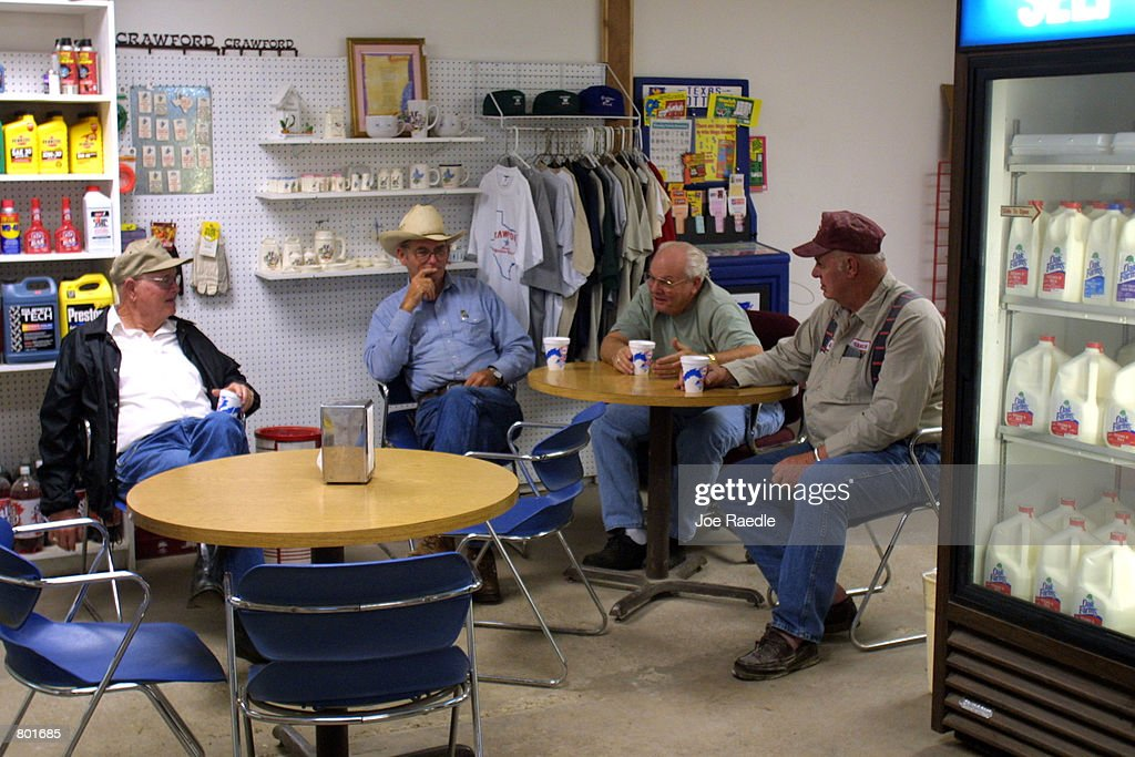 Local ranchers share small talk over a cup of coffee in the early morning April 13 2001 in Crawford Texas Crawford the hometown of US President...