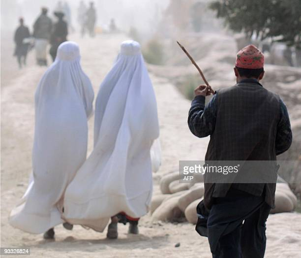 Local reasident accompanies two moslem dressed ladies in the village of Khwaja Bahaulldin Northern Afghanistan some 15 kms from Tajik border 10...
