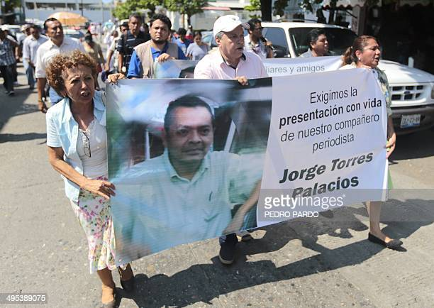 Local reporters march to demand the timely work of the authorities in the case of the kidnapping of the former journalist Jorge Torres in Acapulco...