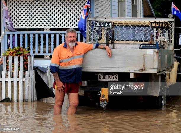 ROCKHAMPTON QLD Local resident Brett James stands in floodwaters at Depot Hill in Rockhampton Queensland after the Fitzroy River burst its banks in...