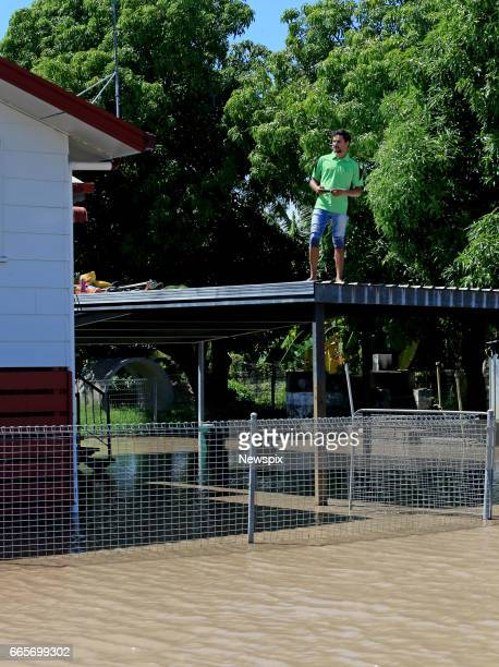 ROCKHAMPTON QLD Local resident Cameron Gooda watches the rising floodwaters at Depot Hill in Rockhampton Queensland after the Fitzroy River burst its...