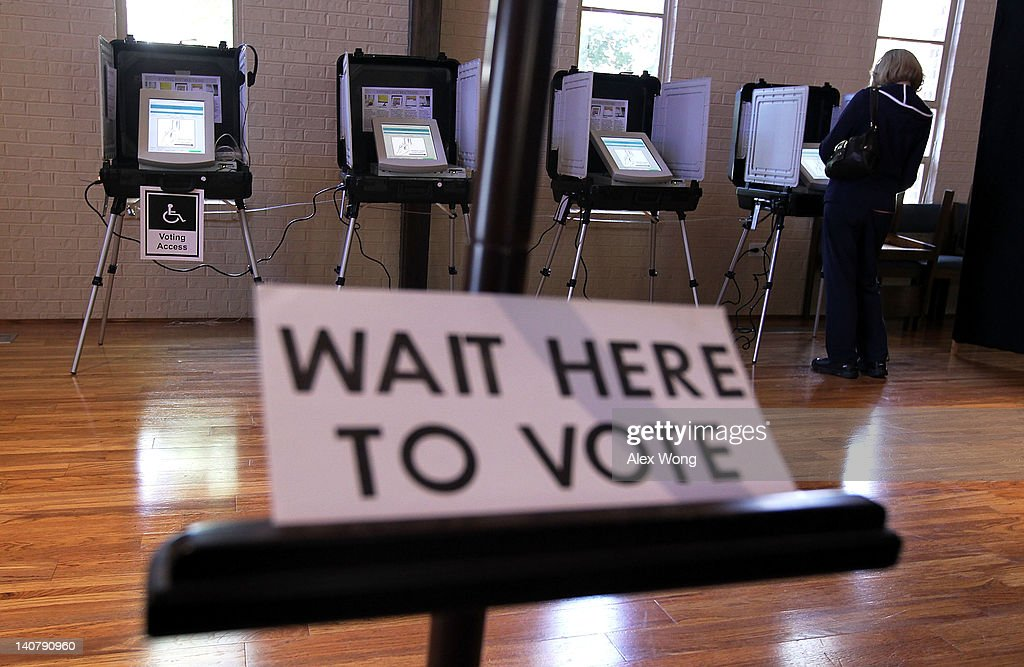 A local resident casts her vote at a polling station in St Andrew Presbyterian Church March 6 2012 in Sandy Springs Georgia Ten states including...