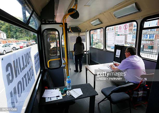 A local resident casts her vote in a bus being used as a temporary polling station in KingstonUponHull northern England on June 23 2016 Millions of...