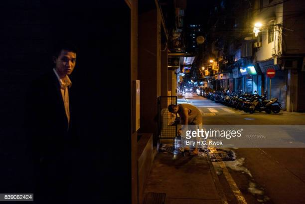 A local resident collects water from a public water tab after water pipes have been broken by Typhoon Hato in Macao on August 23 2017 in Macau China...