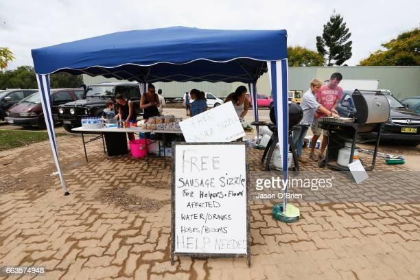 Local Resident cook a free sausage sizzle to feed people assisting the flood clean up on April 2 2017 in Murwillumbah Australia Heavy rain has caused...