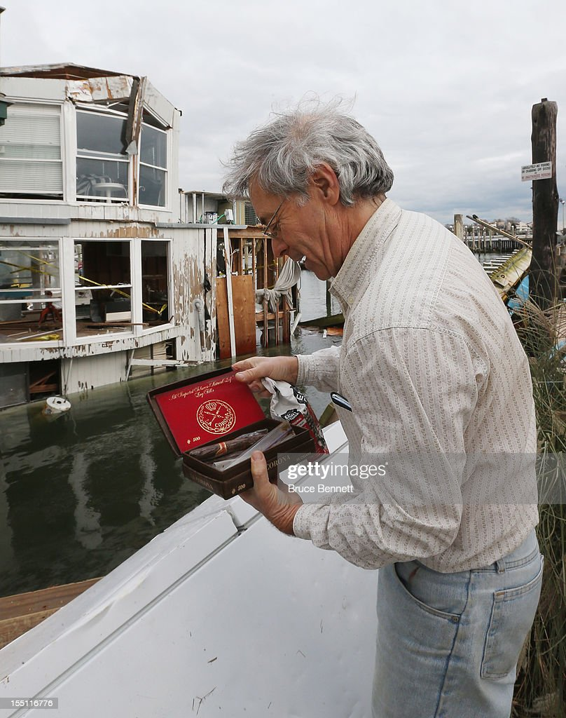Bill Elliot holds a box of his cigars he found in his refrigerator, which was 50 feet from his destroyed house boat in the aftermath of Superstorm Sandy on November 1, 2012 in Merrick, New York. Superstorm Sandy, which has left millions without power or water, continues to effect business and daily life throughout much of the eastern seaboard.