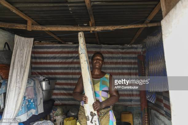 A local resident holds a timber broken after police allegedly stormed the neighborhood during demonstrations looking for protesters and broke down...
