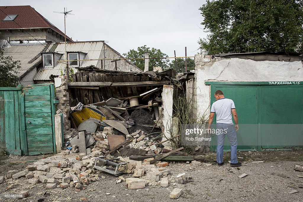 A local resident inspects a garage, damaged by a rocket during fighting between pro-Russia rebels and Ukrainian government troops, on July 21, 2014 in Donetsk, Ukraine. Local authorities warned residents in the area not to go outside or leave their homes whilst intense shelling set a market ablaze close to the station. The security situation is continuing to affect the investigation into the Malaysian Airlines flight MH17 crash and it is still unclear where or when the train containing the bodies of victims will be moved. Malaysian Airlines flight MH17 was travelling from Amsterdam to Kuala Lumpur when it crashed killing all 298 on board including 80 children. The aircraft was allegedly shot down by a missile and investigations continue over the perpetrators of the attack.