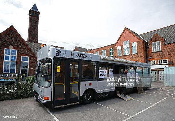 A local resident leaves after casting his vote in a bus being used as a temporary polling station in KingstonUponHull northern England on June 23...