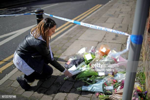 A local resident leaves flowers near the scene in Cranbourne Rd ChorltoncumHardy where exRoyal Navy officer Michael Samwell was fatally injured as he...
