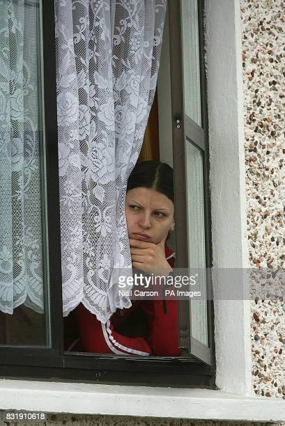 A local resident looks down on the scene in the Donaghmede area of north Dublin after a man in his 20s was shot dead last night in a suspected...