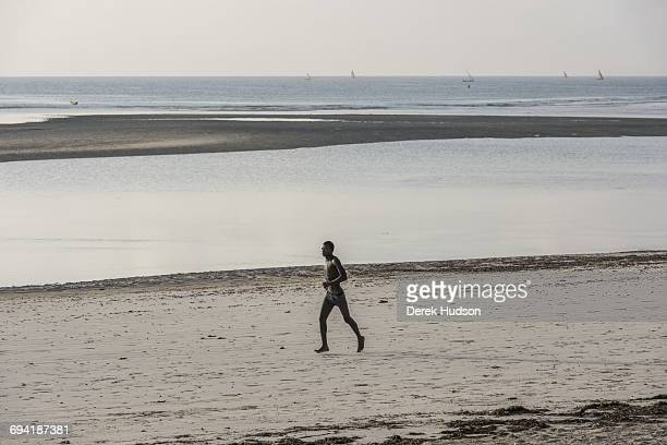 A local resident of Msambweni pictured running on the beach with a sandbank exposed at low tideThe small fishing town and constituency of Msambweni...