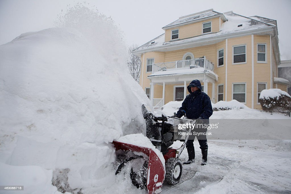A local resident plows snow on February 9 in the Dorchester neighborhood of Boston Massachusetts Boston was hit with a third major snowstorm in three...