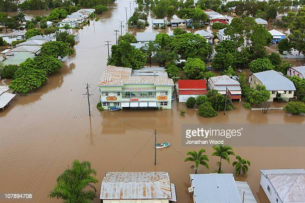 A local resident rows past a pub through flood waters on January 6 2011 in Rockhampton Australia Floodwaters peaked at 92 metres yesterday in the...