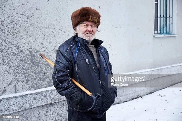 A local resident seeking help looks on as people from the ministry for civil defense and emergencies of the 'Donetsk People's Republic' set up a...