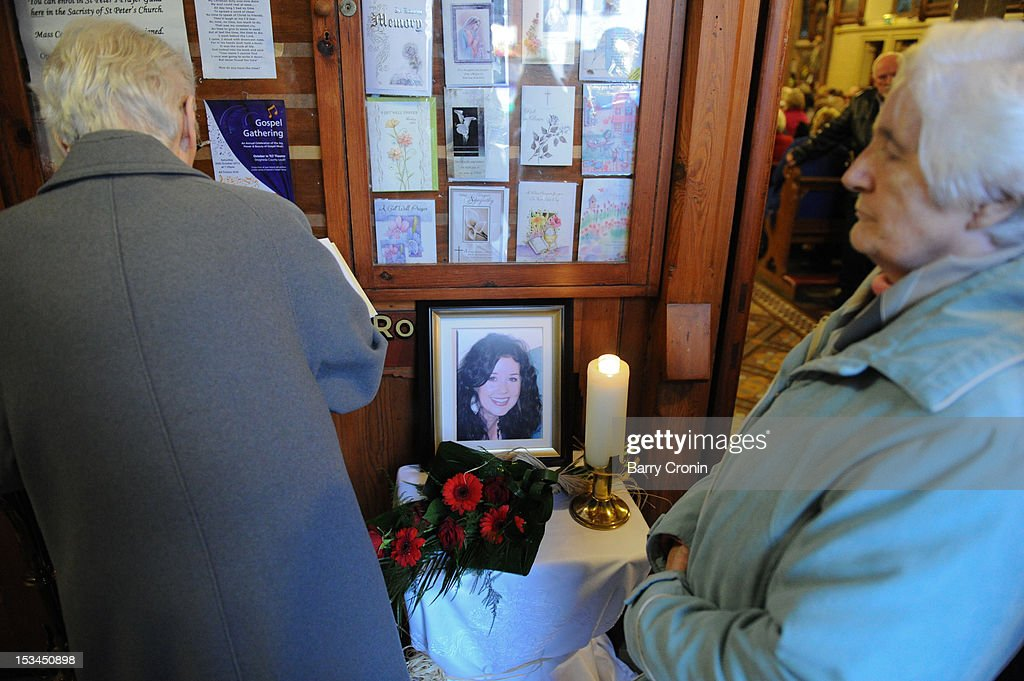 A local resident signs a book of condolence prior to a Memorial Service for murdered journalist Jill Meagher at St. Peter's Church on October 5, 2012 in Drogheda, Ireland. Mrs Meagher, 29, from County Louth was murdered after a night out in Melbourne, Australia, last month.