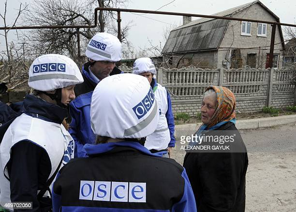 A local resident speaks with Alexander Hug Deputy Chief Monitor of the Organization for Security and Cooperation in Europe Special Monitoring Mission...
