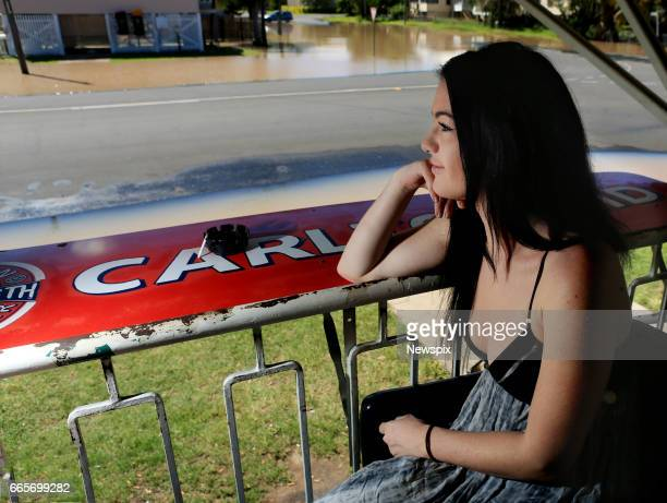 ROCKHAMPTON QLD Local resident Tahlia Thomasson watches the rising floodwaters from the balcony of the Fitzroy Hotel at Depot Hill in Rockhampton...