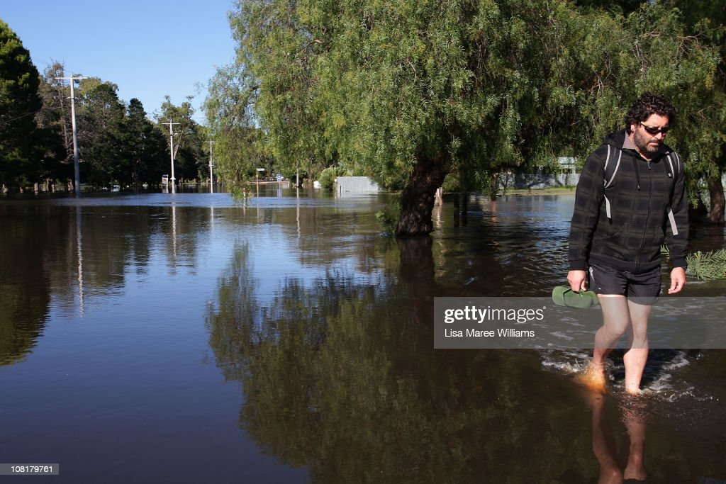 A local resident wades through flood waters from the Wimmera River on January 20, 2011 in Dimboola, Australia. Many towns are ordering evacuations and others towns are isolated as water levels continue to rise with peaks expected in the next few days. Parts of Victoria are experiencing the worst flooding in over 200 years after heavy rainfall inundated the region. The Victorian floods have so far claimed one life, after the body of a missing seven-year-old boy was identified earlier this week.