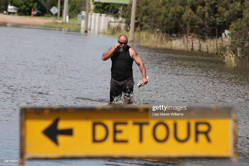 A local resident walks along a flooded residential street on January 18, 2011 in Horsham, Australia. Residents and emergency crews sandbagged properties and evacuations have been ordered in the town experiencing the worst flooding in over 200 years. A relief centre has been set-up in at Horsham Town Hall and emergency crews are on-site as the Wimmera River water level reaches it's peak. The Victorian floods have so far claimed one life, with the body of a missing seven-year-old boy believed to be found earlier today.