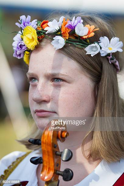 A local resident wears a village dress arrives at market of regional products on 11 September 2016 in the Myslecinek park in Bydgoszcz Poland...