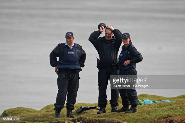 Local residents activists and hundreds of Gardai and private security personnel gather at Glengad Beach in CoMayo as the pipe laying vessel Solitaire...