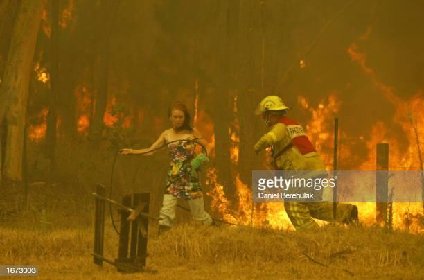 Local residents and firefighters battle the blaze at Glenorie at Glenorie on December 5 2002 in the northwestern suburbs of Sydney Australia Over...