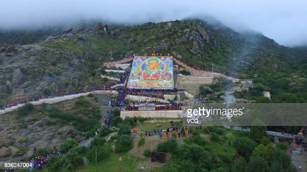 Local residents and tourists worship a large thangka during the Sho Dun Festival at Drepung Monastery on August 21 2017 in Lhasa China The Sho Dun...