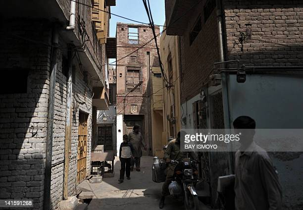 Local residents are seen in alleyways in front of a 200year old house undergoing ownership disputes between heirs residents and the local government...