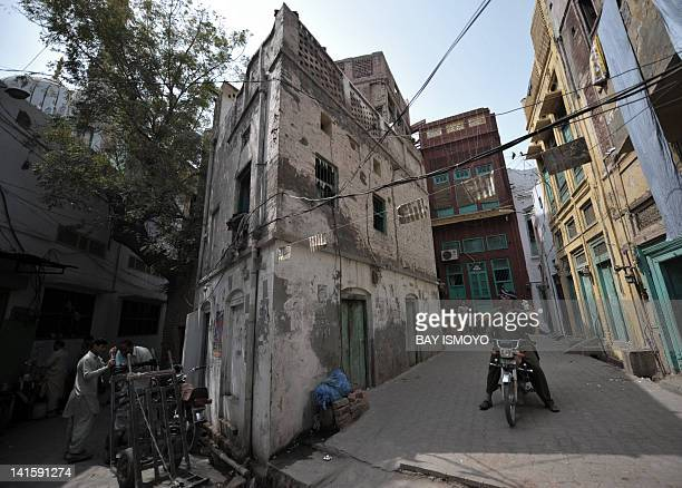 Local residents are seen in narrow alleys in the old town section of Multan on March 17 2012 Multan one of the oldest cities in the Asian...