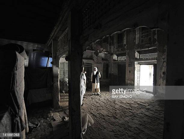 Local residents are seen in the compound of 200year old house undergoing ownership disputes between heirs residents and the local government in the...