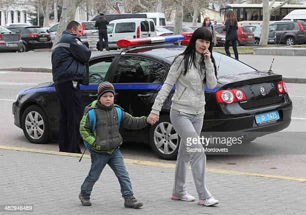 Local residents are seen walking in the street on April 5 2014 in Sevastopol in the disputed Crimean Peninsula Many Ukrainian banks are already...