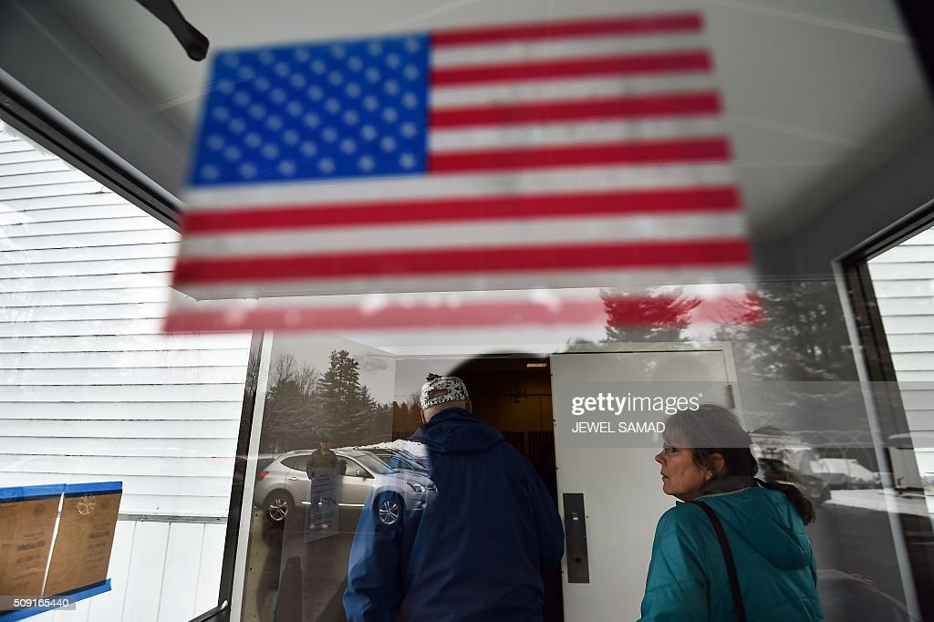 Local residents arrive at a shrine to vote the first US presidential primary in Concord, New Hampshire, on February 9, 2016. New Hampshire voters headed to polls at the snowy break of day on February 9 for the crucial first US presidential primary, with Donald Trump chasing victory and Hillary Clinton looking to narrow the gap on Bernie Sanders. The northeastern state, home to just 1.3 million people, sets the tone for the primaries -- and could shake out a crowded Republican field as the arch-conservative Senator Ted Cruz and establishment candidates led by Marco Rubio battle for second place behind the frontrunner Trump. / AFP / Jewel Samad