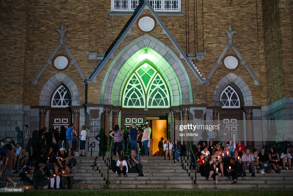 Local residents attend a public vigil at the PresbyteresEglises July 12 2013 in LacMegantic Quebec Canada A train derailed and exploded into a...