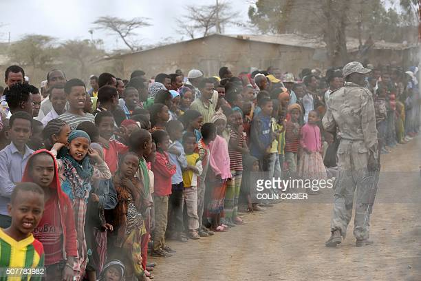 Local residents await the arrival of the UN secretarygeneral in Ogolcho in Ethiopia's drought affected Oromia region to tour various UN drought...