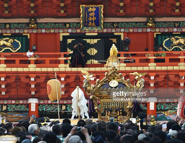 Local residents carry a portable shrine into the KandaMyojin shrine in downtown Tokyo during the its summer festival called the Kanda Matsuri on May...