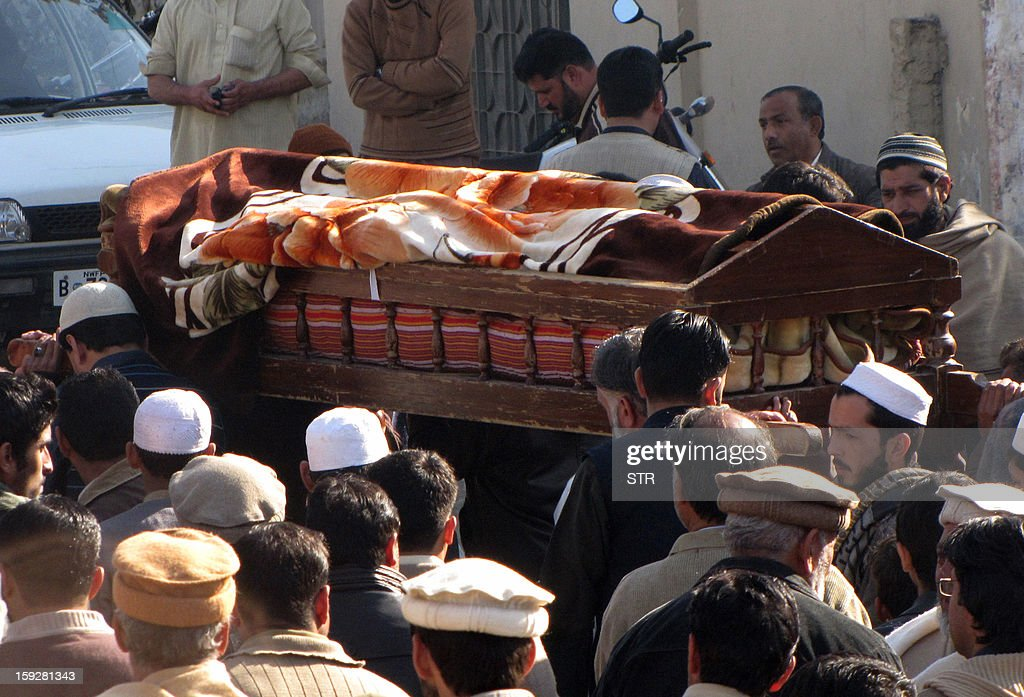 Local residents carry the coffin of a bomb blast victim during a funeral in Mingora, the main town in the district, on January 11, 2013. An explosion at a religious gathering in Pakistan's northwestern Swat valley that killed 22 people and wounded more than 80 was caused by a bomb, officials said Friday.