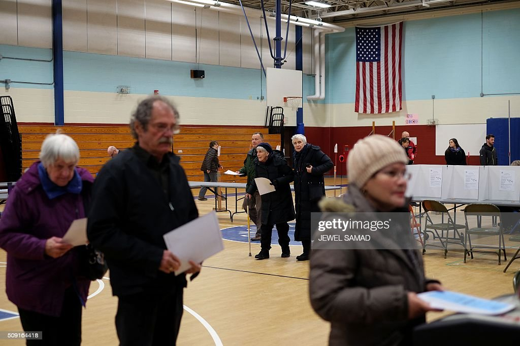 Local residents cast their ballots for the first US presidential primary at a school gym in Concord, New Hampshire, on February 9, 2016. New Hampshire voters headed to polls at the snowy break of day on February 9 for the crucial first US presidential primary, with Donald Trump chasing victory and Hillary Clinton looking to narrow the gap on Bernie Sanders. The northeastern state, home to just 1.3 million people, sets the tone for the primaries -- and could shake out a crowded Republican field as the arch-conservative Senator Ted Cruz and establishment candidates led by Marco Rubio battle for second place behind the frontrunner Trump. / AFP / Jewel Samad