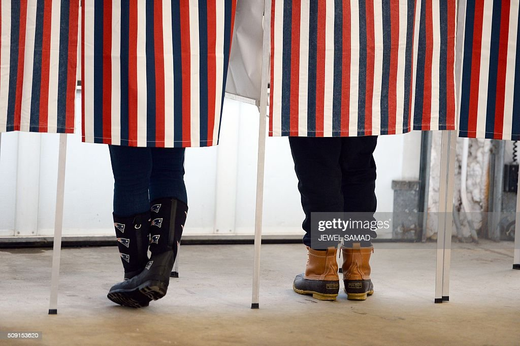 Local residents casts their ballot to vote for the first US presidential primary at a fire station in Loudon, New Hampshire, on February 9, 2016. New Hampshire began voting on February 9 in the first US presidential primary with Republican Donald Trump calling on supporters to propel him to victory and Democrat Bernie Sanders primed to upstage Hillary Clinton. The northeastern state, home to just 1.3 million people, sets the tone for the primaries and could shake out a crowded Republican field of candidates pitting Trump and arch-conservative Senator Ted Cruz against more establishment candidates led by Senator Marco Rubio. SAMAD